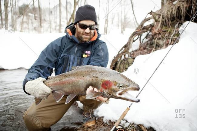 Fisherman showing off rainbow trout