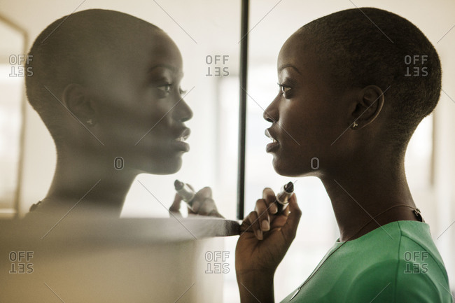 Woman staring at her reflection
