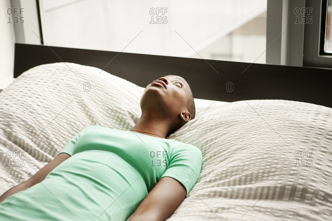 Woman staring at the ceiling in the bedroom