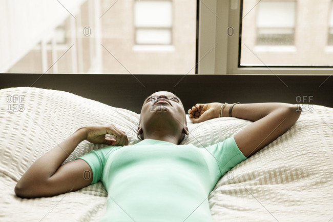 Close-up of woman lying on bed