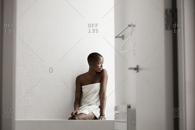 Woman wrapped in towel in a bathroom