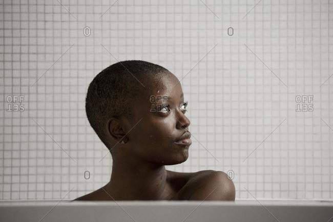 Portrait of woman in a bathtub