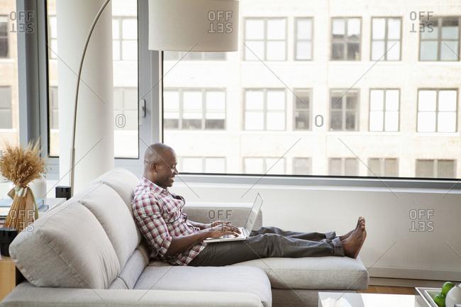 Man using his laptop at home