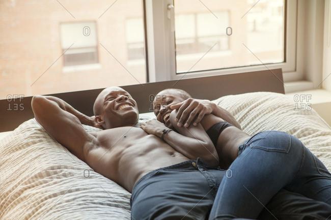 African American couple in bedroom