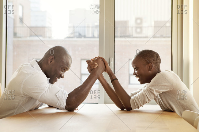 African American couple arm wrestling