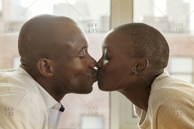 Close up of African American couple kissing