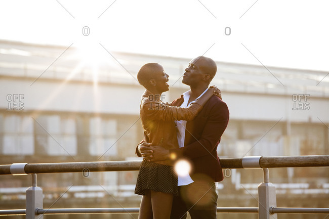 African American couple having conversation on pier