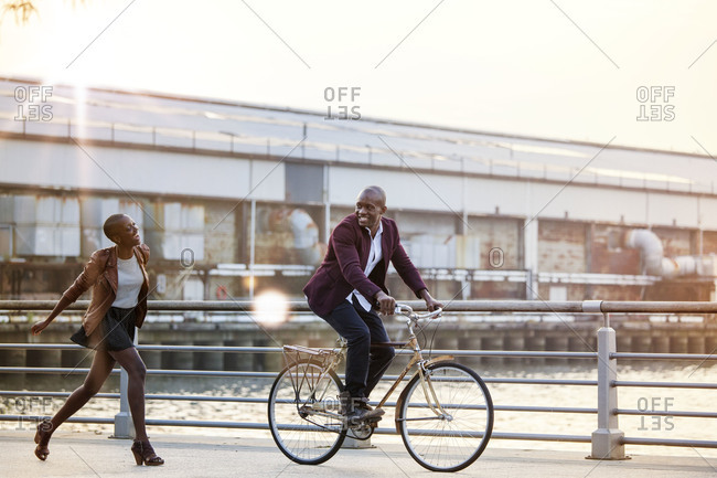 Girlfriend running after boyfriend on bike