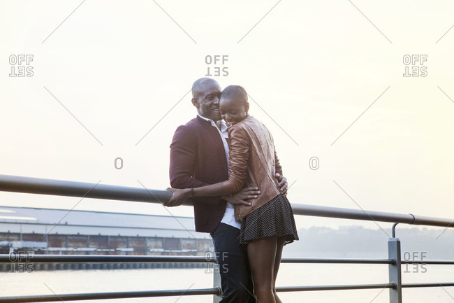 African American couple enjoying time together on pier