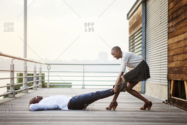 African American woman pulling her boyfriend