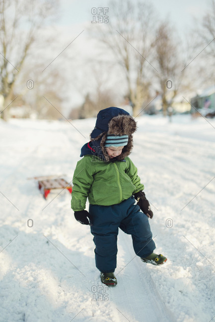 Young boy playing the snow