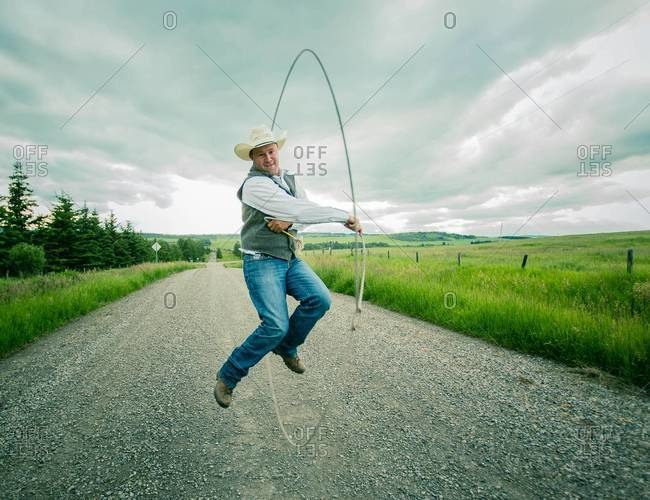 Man spinning a lasso rope outdoor