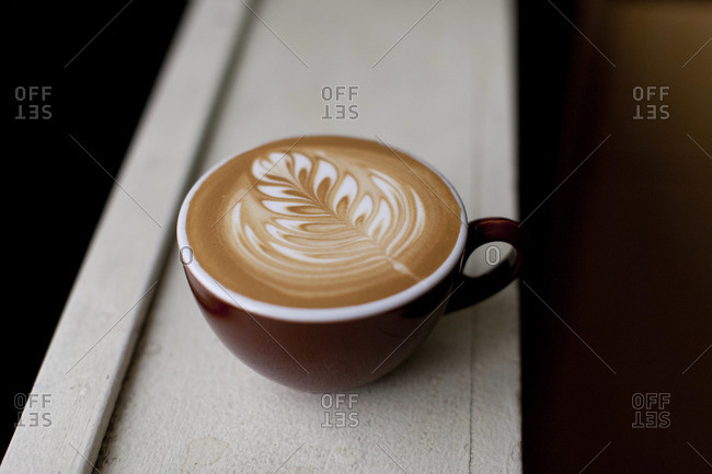 Close-up of a cup of coffee with latte art