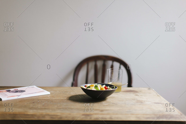 A bowl of summer pasta on a wooden table