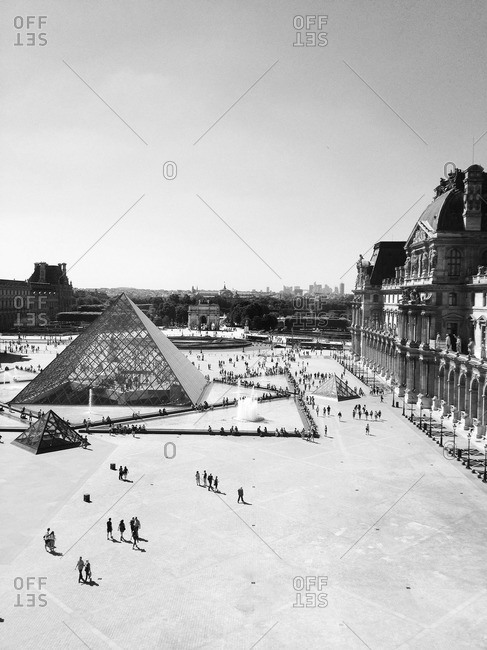 PARIS - May 25, 2012: The Louvre Pyramid during the day