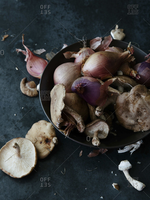 Close-up of a bowl of mushrooms and onions
