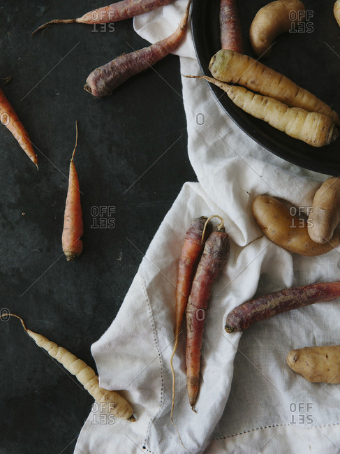 Close-up of scattered carrots and potatoes