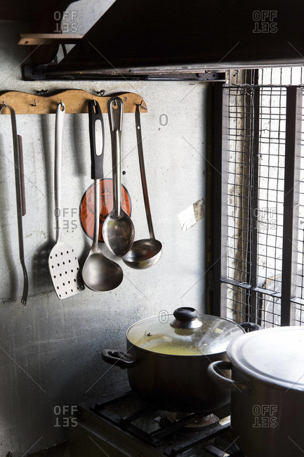 Ladles and pots on stove