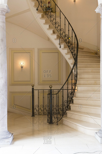 Interior staircase with wrought iron railing