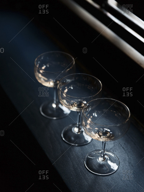 Three cocktail glasses on countertop