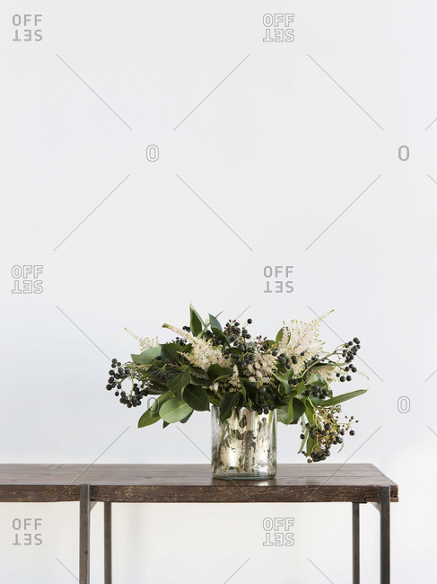 Bouquet of flowers in vase on table