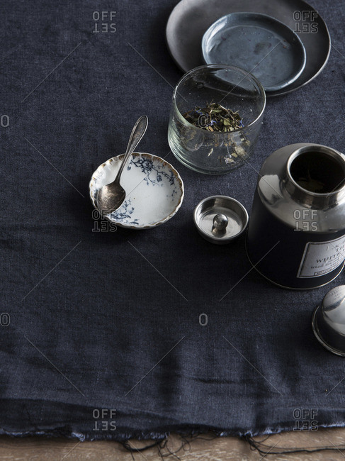 White tea leaves in glass on table