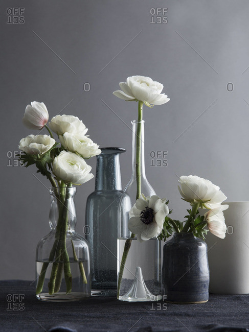 White flowers in different shape of vases