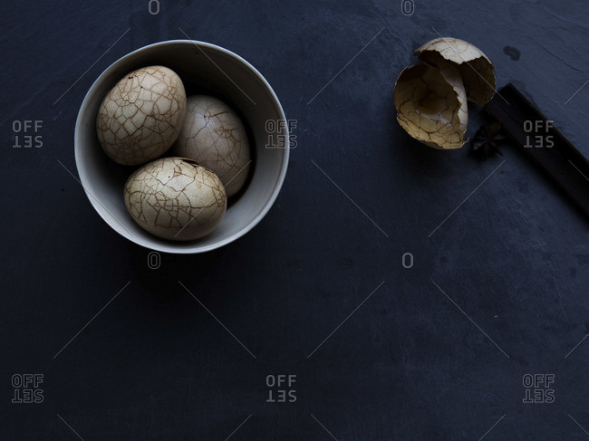 Still life of cracked Chinese tea eggs in bowl
