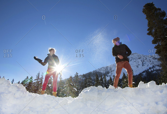 Couple snowball fighting