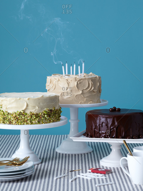 Birthday cakes against blue background