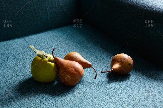 Pears on blue textile