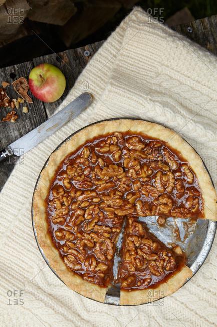Top view of walnut caramel tart