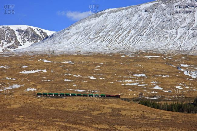 Freight train passing through Bridge of Orchy, Scotland