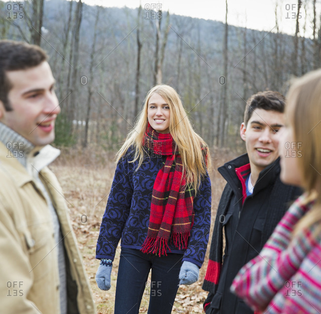 Four people outdoors on a winter day.