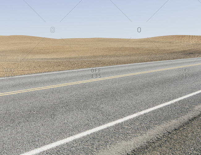 Road through ploughed farmland, near Pullman