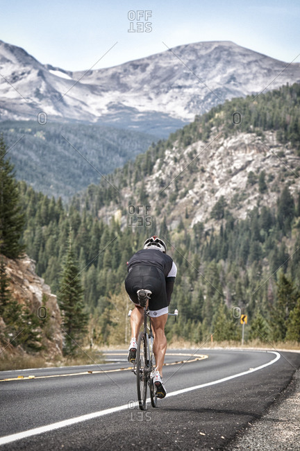 A cyclist rides the Peak-to-Peak highway