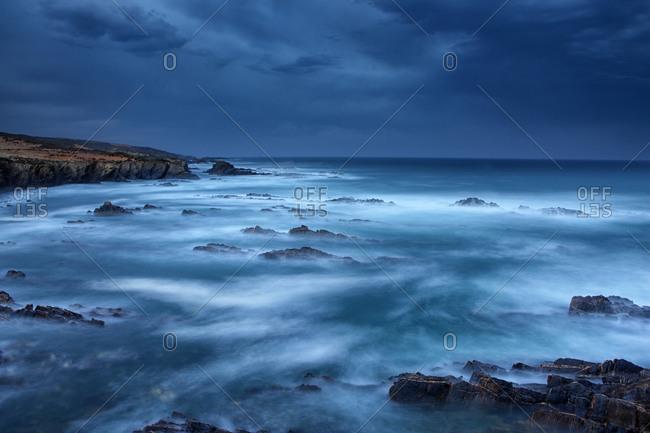 Dark shales Sunset over the coast of Almograve in Alentejo coast. Portugal