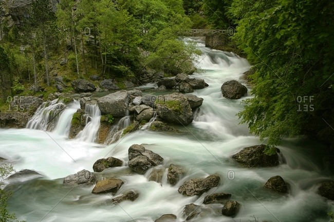 Arazas River surrounded abundant greenery in the National Park of Ordesa and Monte Perdido