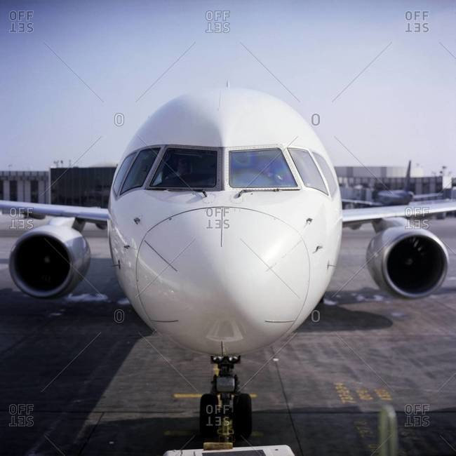 Commercial airline jet parked at gate