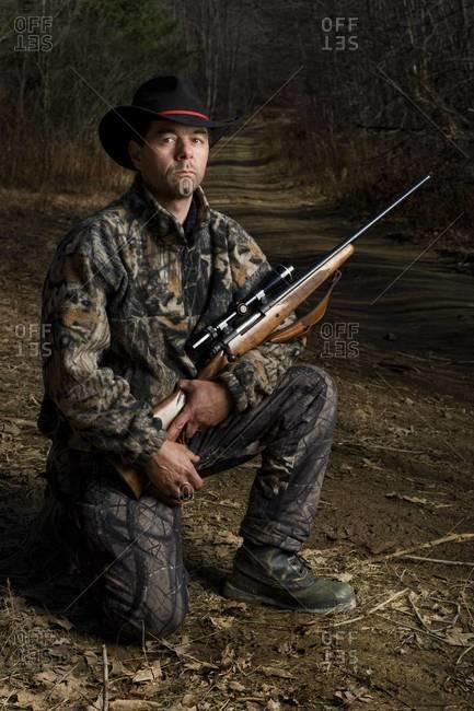 Portrait of  hunter with shotgun