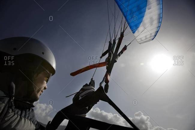 Close up of man piloting a paraglide