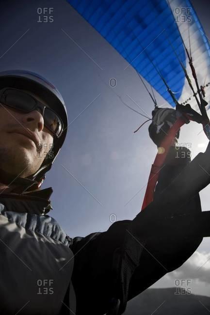 Man piloting a paraglide