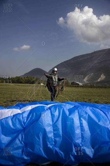 Paraglide pilot packing his glide