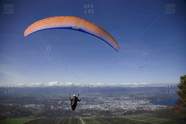 Rear view of paraglider in flight