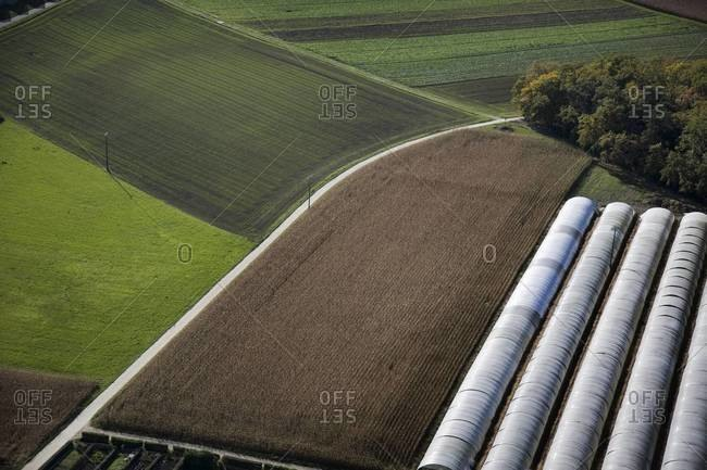 Aerial view of farmland with greenhouses