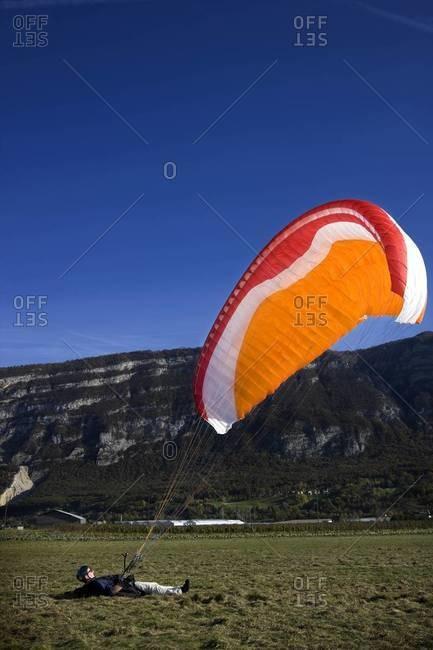 Landed paraglider on field