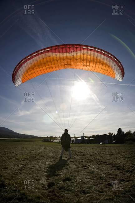 Landing paraglider on field