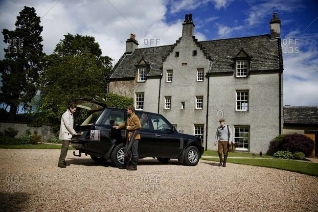 Elegant hunters packing a car