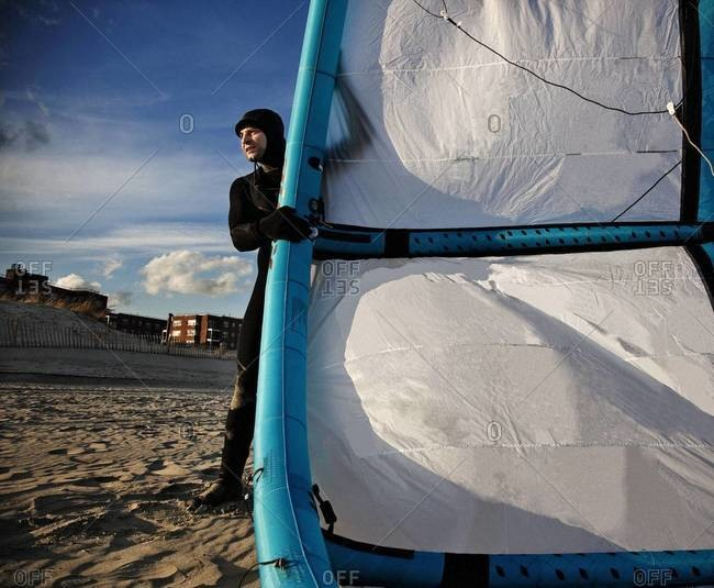 Close up of kiteboarder preparing his kite on the beach