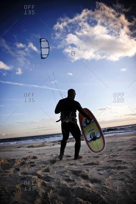 Kiteboarder prepares and launches his kite